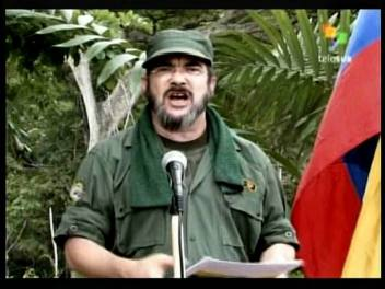 """TV grab taken from Venezuelan broadcast TELESUR of a video released on May 25, 2008 by the Revolutionary Armed Forces of Colombia (FARC), showing Timoleon Jimenez, known as """"Timochenko"""". Colombia's long-fighting Marxist FARC rebels have named a new leader after the death of their leader Alfonso Cano earlier this month in a clash with government forces, local media reported Tuesday. AFP PHOTO/TELESUR"""
